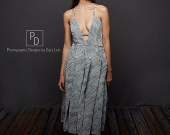 Unique gray pleated and textured dress with plunging neckline and fringe details