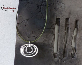 Necklace, rings, pistachio green leather
