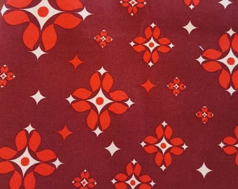 "Free Spirit, 100% cotton fabric. Grand Hotel by Jenean Morrison. ""Concierge"" in red."