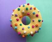 Nipply nip donut crochet cushion