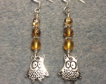 Silver silly owl charm earrings adorned with amber Czech glass beads.
