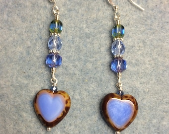 Opaque light blue Czech glass heart bead dangle earrings adorned with light blue Czech glass beads.