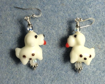 White lampwork puppy dog bead earrings adorned with clear Czech glass beads.