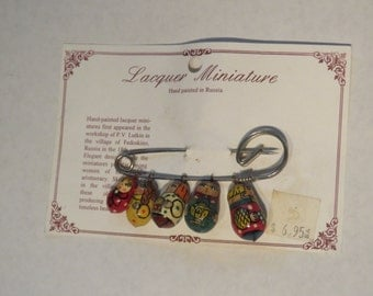 Miniature lacquer nesting doll pin - vintage