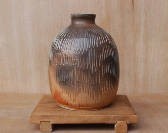 Small wood fired porcelain bud vase with vertical texture