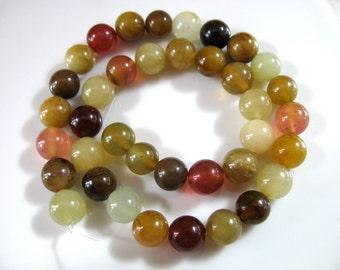 Soocho Jade, 38 beads, 8mm, multicolor, muted amber, green, yellow and brown - 467