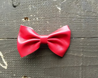 Red faux leather bow