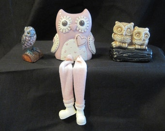 3 owl figurines