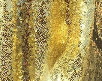 "60"" w Small shiny yellow gold sequin fabric"