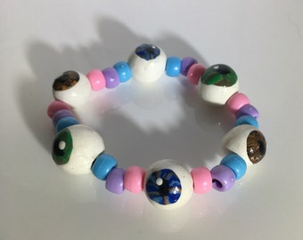 Creepy doll eye bracelet pastel goth horror weird eyeball jewelry