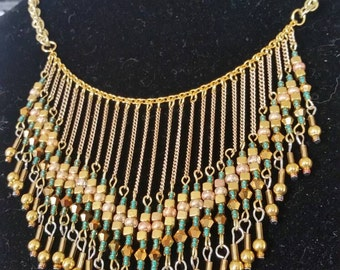 Gold fringe bib necklace