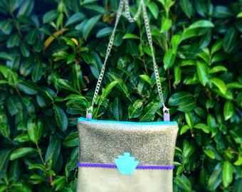 Tassel balances and yoke Glitter clutch bag