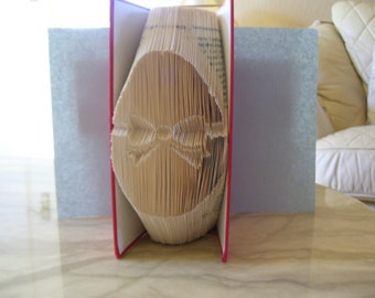 Book folding art pattern for an Easter Egg with Bow