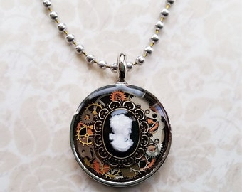 Tiny cameo steampunk watch part and gears resin pendant