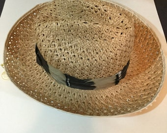 Vintage straw hat with feather band, sort of fedora style, shaped crown plastic trimmed brim open weave original price tag
