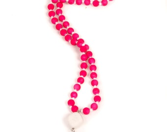 Neon pink necklace with white accents and tassel