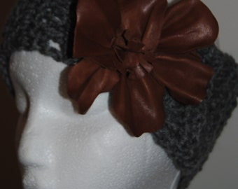 Fabulously fun and  trendy grey crochet headwrap with tan leather floral detail.