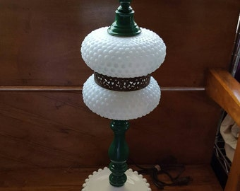 Hobnail emerald green lamp with brass trim.