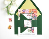 Gorgeous spring wedding invitation adorned with beautiful vibrant flowers