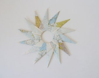 large paper star, world map, an Atlas
