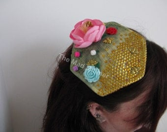 From flower to bee hive fascinator