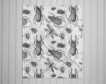 Black and white vintage bugs plush throw blanket with white back