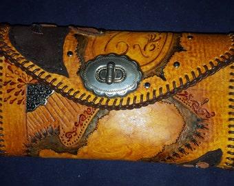 Hand tooled custom leather clutch handbag