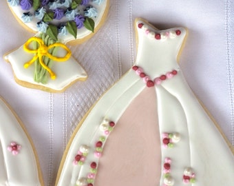 Wedding bouquets and wedding gown cookies.