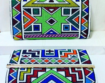 Ndebele beaded clutch purse 30cm long and 19cm width.