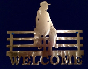 Metal Cowgirl Fence Sitting Welcome Sign