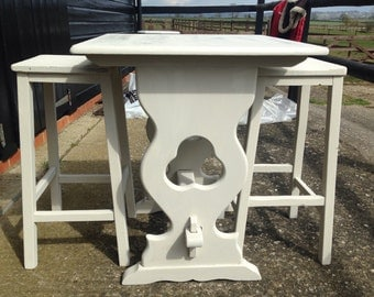 Antique style table with cut out detail.