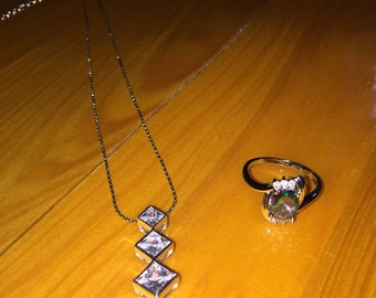 Journey pendant with a mystic topaz ring!Set in sterling silver! Estate vintage