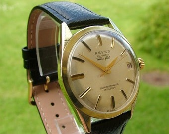 A vintage gents 1960s Reves Ultra Flat Superautomatic wrist watch