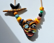 """Neckless """"African pirate"""" Materials: handmade modeling clay pendant, beads, lava beads, leather rope. Only one original!"""