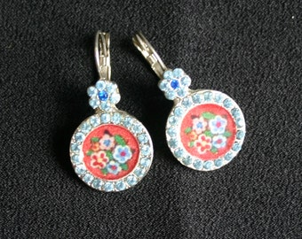 Vintage pierced earrings.   Blue floral design with silver tone metal.   Very beautiful. Would make a lovely gift.
