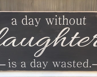 """Rustic Wood Sign - A Day Without Laughter Is A Day Wasted - 12"""" x 24"""""""