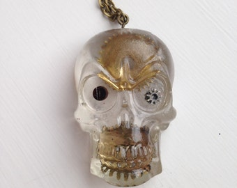 Handcast resin skull necklace with antique cogs
