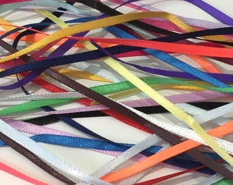 Bundle of 20 different  1mtr length pieces of 3mm wide double sided satin ribbon.