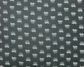 """Itty bitty skulls on soft, stretchy cotton jersey, 60"""" wide x 26"""" long"""