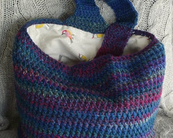 Unstructured, slouchy, hobo shoulder bag crocheted outer, lined in contrasting cotton with 2 pockets and key fob
