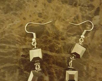 Unique but daring silver iris earrings