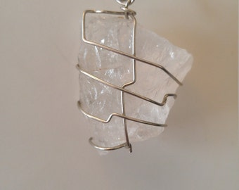 Quartz silver wire wrapped pendant.