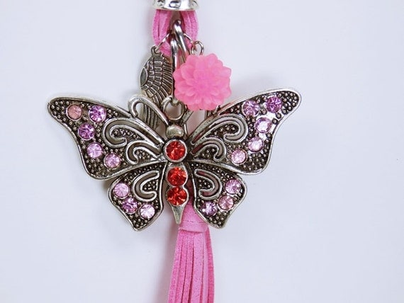 Necklace Silver butterfly in pink with rhinestones in pink and red on pink leather strap with pink flower, angel wings and Tassel