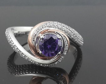 Purple swirl trilogy ring with cz