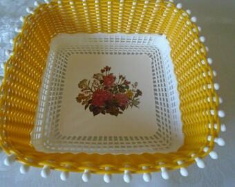 Bright yellow plastic woven bread/fruit basket