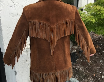 Pioneer wear 60's fringe leather jacket dry cleaned and in percect condition smells like leather size 18