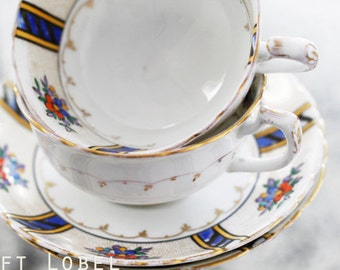 Antique 1920s Tuscan-Plant China, England pair of teacups and saucers, Art Deco-style, goldgilt dots and garlands, floral pattern