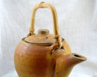 Ochre ceramic teapot