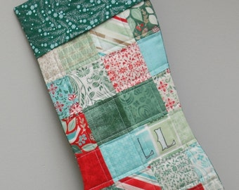 Handmade patchwork quilted Christmas stocking.
