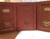 """Custom leather hardback trio of Suzanne Collins' """"The Hunger Games"""" series"""